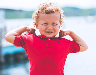 Preschool boy showing how strong he is
