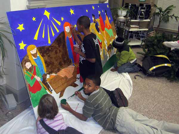 Children painting nativity sign at SOS Center